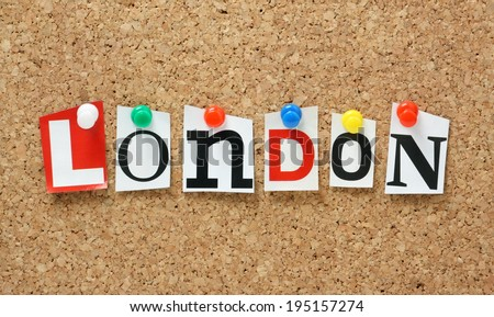 The name London in cut out magazine letters pinned to a cork notice board