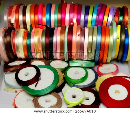 the narrow multicolored bright ribbons for needlework
