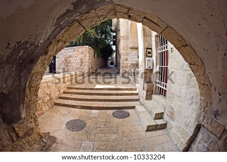 The narrow street in the Jewish Quarter of Jerusalem. - stock photo