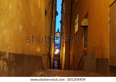 The narrow street of Gamla Stan - historic city old center of Stockholm, - stock photo