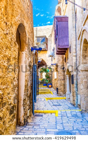 The narrow street of the medieval quarter in upper town of Jaffa, Tel Aviv, Israel. - stock photo