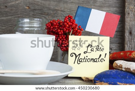 The National Celebration In France La fête nationale (Bastille Day) - text, Heart shaped cookies color red, blue, white. Cup of coffee (tea), france flag, decoration. Patriotic Breakfast Concept.