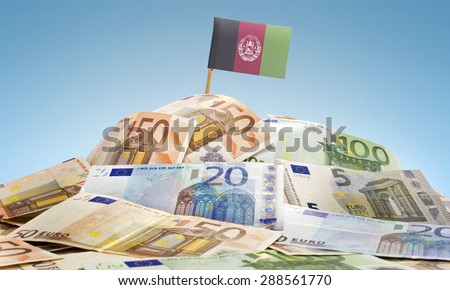 The national flag of Afghanistan sticking in a pile of mixed european banknotes.(series) - stock photo