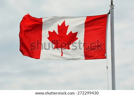 The National flag of Canada the Maple Leaf forever. - stock photo