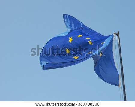 The national flag of European Union floating over blue sky
