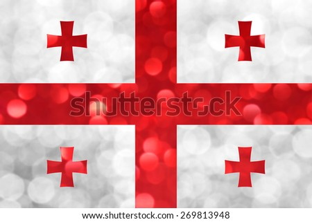 The National flag of Georgia made of bright and abstract blurred backgrounds with shimmering glitter - stock photo
