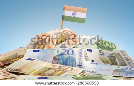 The national flag of India sticking in a pile of mixed european banknotes.(series)