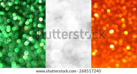 The National flag of Ireland made of bright and abstract blurred backgrounds with shimmering glitter - stock photo