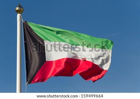 The national flag of Kuwait - stock photo