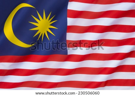 The national flag of Malaysia, also known as the Jalur Gemilang (Malay for Stripes of Glory). The flag was first raised on 16th September 1963, and originated from the flag of the Federation of Malaya - stock photo