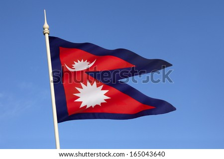 The national flag of Nepal is the world's only non-quadrilateral national flag. Until 1962, the flag's emblems, the sun and the crescent moon, had human faces. They were removed to modernize the flag. - stock photo