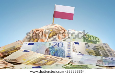 The national flag of Poland sticking in a pile of mixed european banknotes.(series) - stock photo