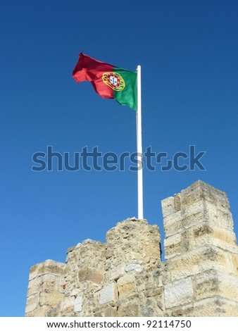 The national flag of  Portugal on the Saint George castle in Lisbon