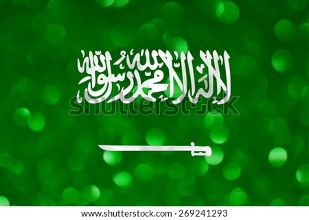 The National flag of Saudi Arabia made of bright and abstract blurred backgrounds with shimmering glitter