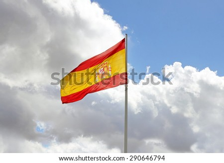 The national flag of Spain against the sky - stock photo