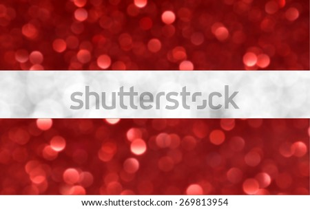 The National flag of the Republic of Latvia made of bright and abstract blurred backgrounds with shimmering glitter - stock photo