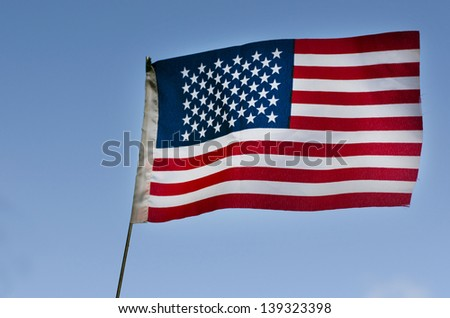 The national flag of the United States of America wave in the wind. - stock photo