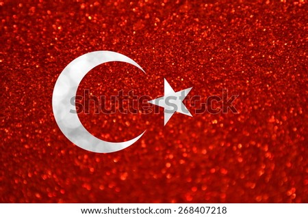 The National flag of Turkey made of bright and abstract blurred backgrounds with shimmering glitter - stock photo