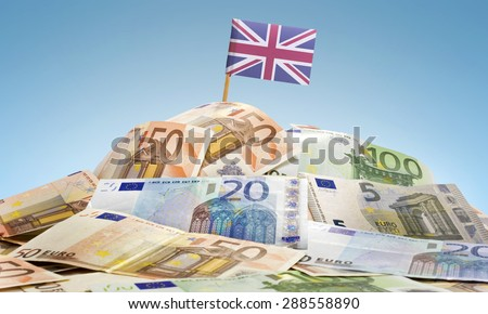 The national flag of United Kingdom sticking in a pile of mixed european banknotes.(series) - stock photo