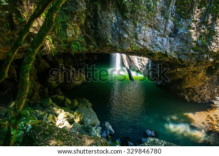The Natural Bridge waterfall at Springbrook National Park in Queensland Australia - stock photo