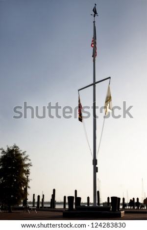 The nautical double mast flagpole in Susan B Campbell Park at the city dock in downtown Annapolis, Maryland in the early morning. - stock photo