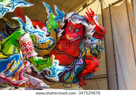 The Nebuta float store in a large shed during daylight hours before parade in night time. For Aomori Nebuta Matsuri, Japanese summer festival at Aomori city, Japan on August 5, 2015. - stock photo