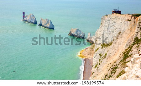 The Needles Isle of Wight UK close to Alum Bay chalk stacks and lighthouse tourist attraction  - stock photo