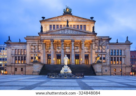 The neo-classical theatre building is used as a concert hall, and is home of the Berlin Symphony Orchestra. It is located in the Gendarmenmarkt near Unter den Linden. - stock photo