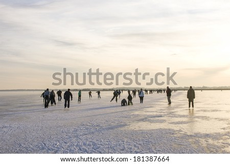 THE NETHERLANDS-FEB 9: Ice skaters on frozen lake in the north of the Netherlands on feb 9, 2012.