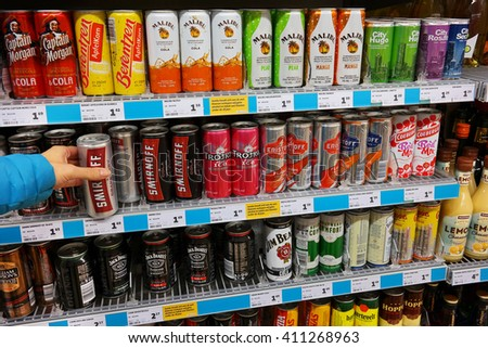 THE NETHERLANDS - OCTOBER 31, 2015: Shelves with Alcopop in a Jumbo supermarket. Coolers are certain flavored alcoholic beverages with relatively low alcohol content.