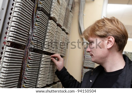 The network engineer working on DDF at telecom room - stock photo