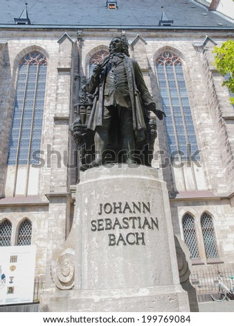The Neues Bach Denkmal meaning new Bach monument stands since 1908 in front of the St Thomas Kirche church where Johann Sebastian Bach is buried - stock photo