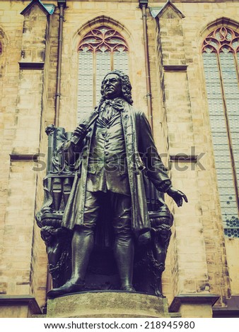 The Neues Bach Denkmal meaning new Bach monument stands since 1908 in front of the St Thomas Kirche church where Johann Sebastian Bach is buried in Leipzig Germany - stock photo