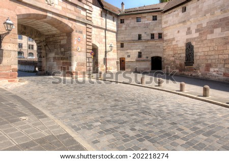 The Neutor, despite the name, dates from 1377 and is one of the ancient gates that lead through the city walls into the old town of Nuremberg. - stock photo