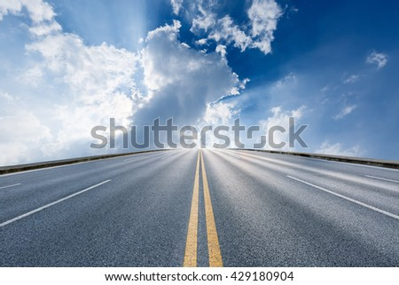 The new asphalt highway is under the blue sky