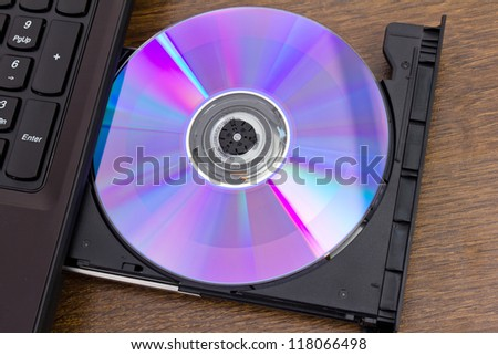 the new DVD disk cutting-in in a notebook