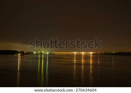 The New Europe Bridge on Danube by night, previously known as the Danube Bridge 2 is a road and rail bridge between the cities of Vidin, Bulgaria and Calafat, Romania. It is a cable-stayed bridge. - stock photo