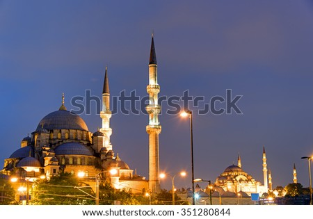 The New Mosque and the Suleymaniye Mosque in Istanbul at night - stock photo