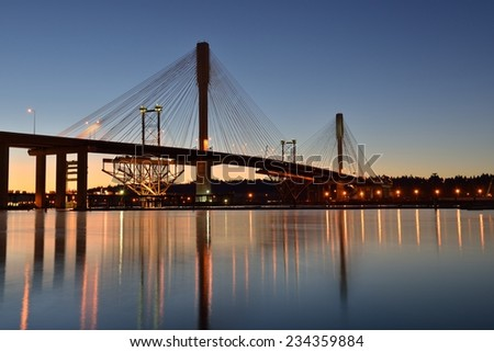 The New Port Mann Bridge at sunrise, one of the widest bridges in the world - stock photo