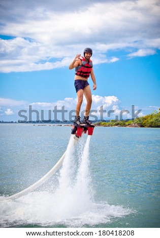 The new spectacular extreme sport called  flyboard, Cambodia. - stock photo