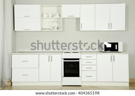 The new white kitchen interior, close up - stock photo