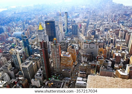 The New York City Manhattan midtown aerial panorama view with skyscrapers and blue sky in the day. - stock photo