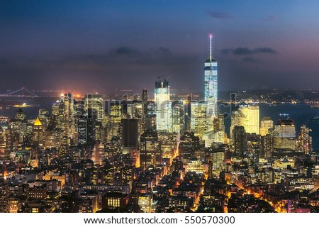 The New York City skyline in the night w the Freedom tower