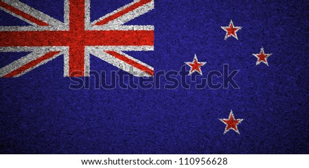 The New Zealand flag painted on a cork board. - stock photo