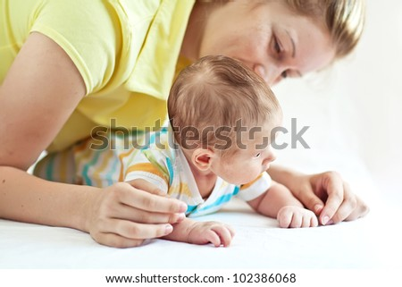 the newborn baby with his mother