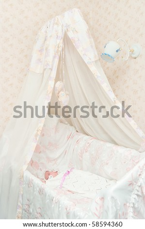 The newborn child in a bed with a canopy