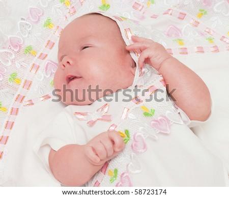 The newborn child  lies - stock photo