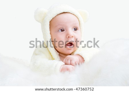 The newborn is dressed in a suit of a bear cub
