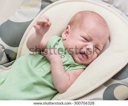 The newborn one-month baby lies and cries - stock photo