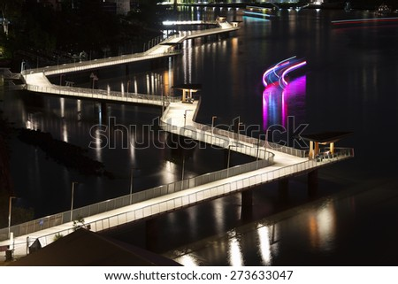 The Newfarm Riverwalk in Brisbane, Queensland, Australia. A scenic place to walk along or ride your bike with views of the Story Bridge and Brisbane City.